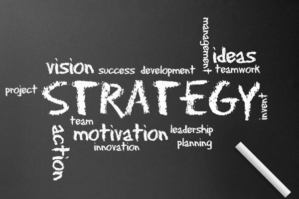 Dark chalkboard with a Strategy diagram illustration.