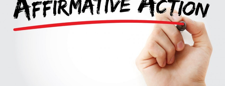 Hand writing Affirmative Action with marker concept background